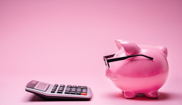 Piggybank Wearing Glasses And Calculator On Pink Background